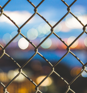 A close up shot of a chain link fence.