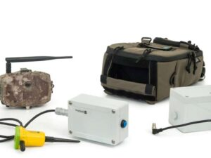 A covert camera kit with camera that looks like a stone and underground motion detectors and backpack