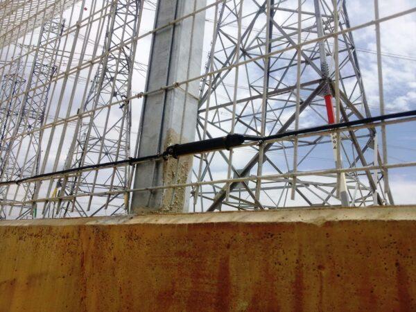 A close up shot of an Elec Sens motion sensor mounted to a fence.