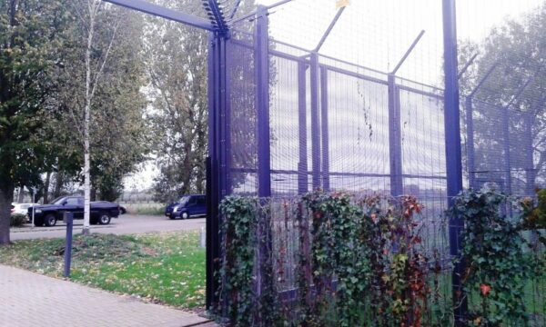 A perimeter fence with an Elec Sens motion sensor detector kit mounted to it.