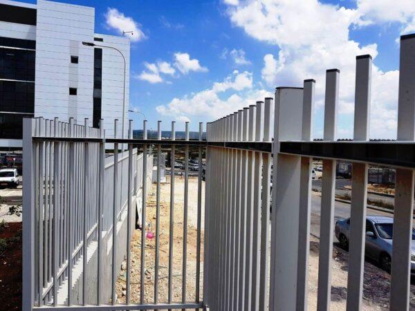 A perimeter fence securing a company car park.