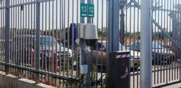 A laser detection system mounted to a metal fence.
