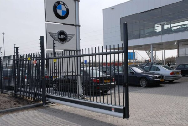 POWER-SENS security system mounted on a metal security fence in a vertical style. Protecting a BMW dealership.