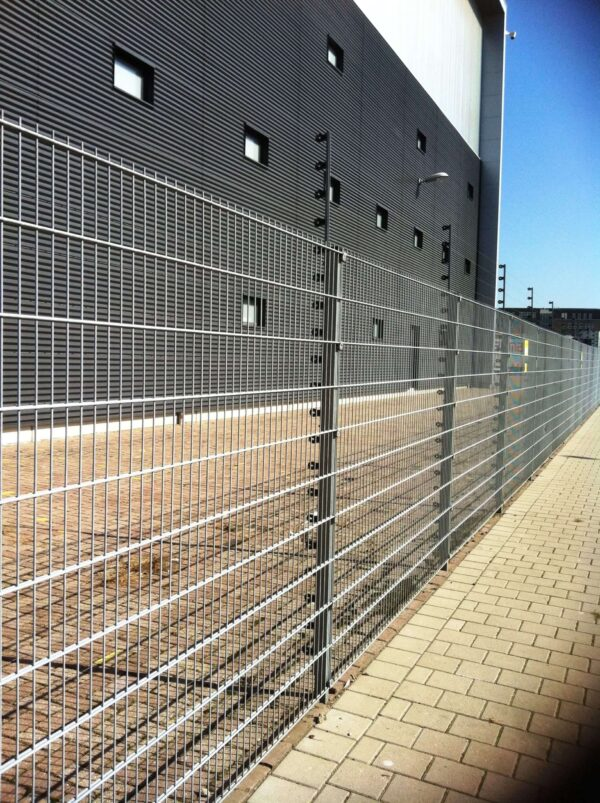 Large commercial storage building with perimeter fencing around it.