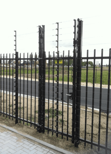 POWER-SENS Gates security system mounted to a games and fence