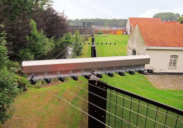 POWER-SENS security system mounted on a metal security fence in a horizontal form.