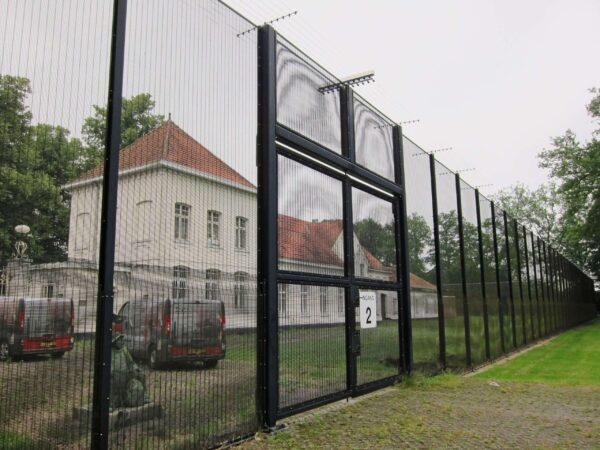 POWER-SENS security system mounted on a high metal security fence.
