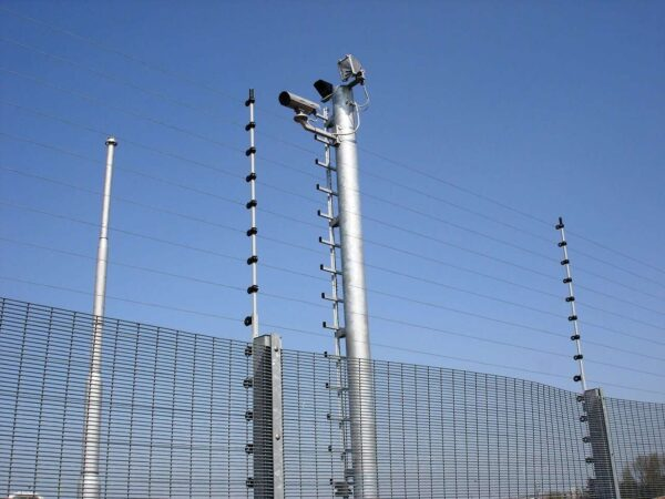 A POWER-SENS security system mounted on a metal security fence coupled with a CCTV system on a mast.