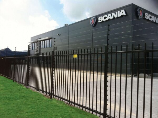 POWER-SENS security system mounted on a metal security fence protecting a Scania building