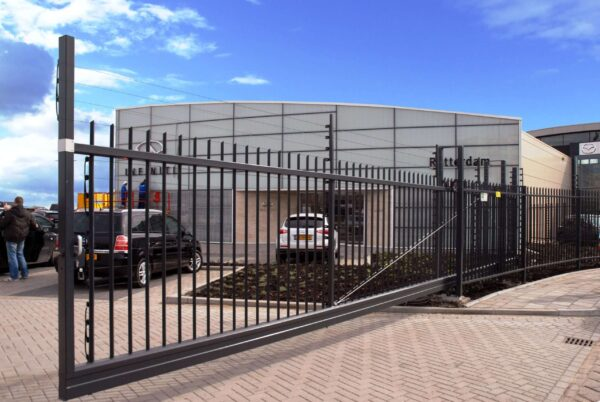 POWER-SENS security system mounted on a metal security gate surrounding a building.