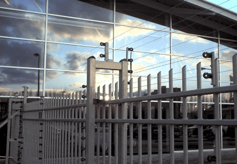 POWER-SENS security system mounted on a metal security fence.