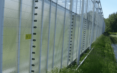 POWER-SENS security system mounted on the side of a greenhouse
