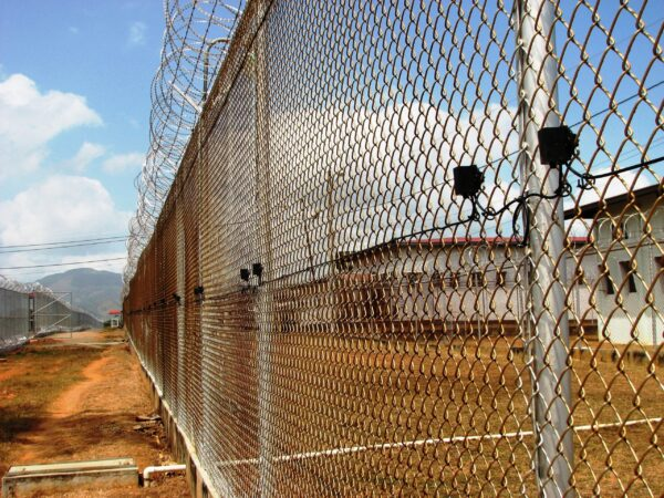 A perimeter fence with a detection system mounted to it