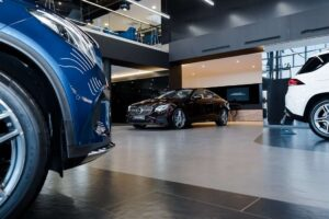 Car dealership showroom with Mercedes and prestige vehicles
