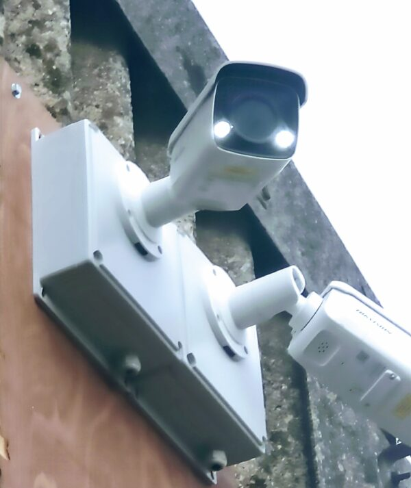 Smart CCTV with lights mounted on a wall