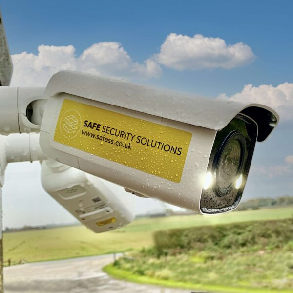 Safesitecam Smart AI Security Camera mounted on a wall in front of a landscape and clouds