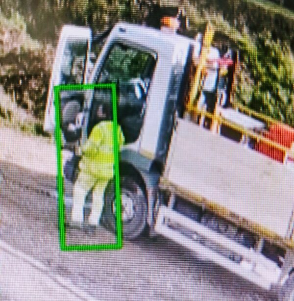 CCTV footage highlighting a person in front of an HGV