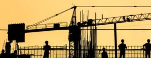 A yellow banner with construction workers in silhouette.